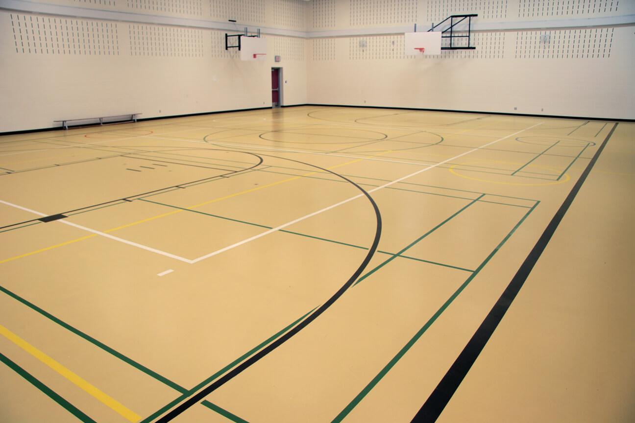 Gymnasium flooring poured polyurethane at Panorama Hills School (Calgary, Alberta)
