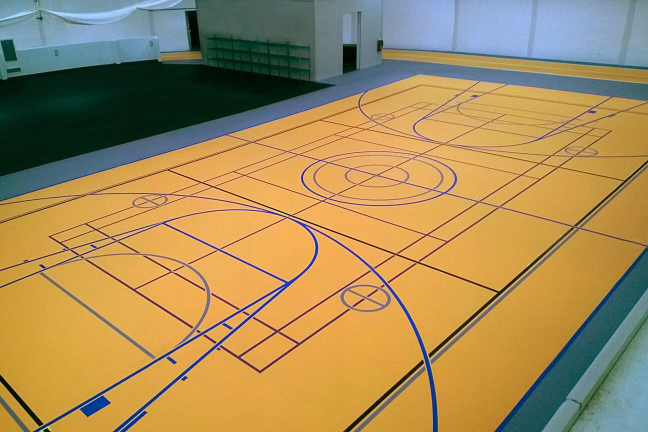 Gymnasium flooring poured polyurethane at Shell Carmon Creek (Alberta)
