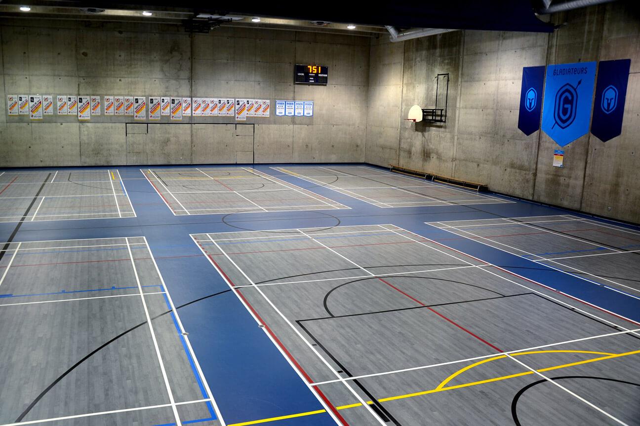Gymnasium flooring Omnisports 6.5 with badminton priority at Gérald-Godin Cegep (Montreal, Quebec)