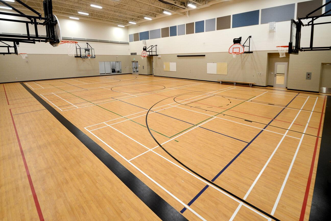 Gymnasium flooring Omnisports 6.5 at St. Lorenzo Ruiz Catholic School (Saskatoon, Saskatchewan)