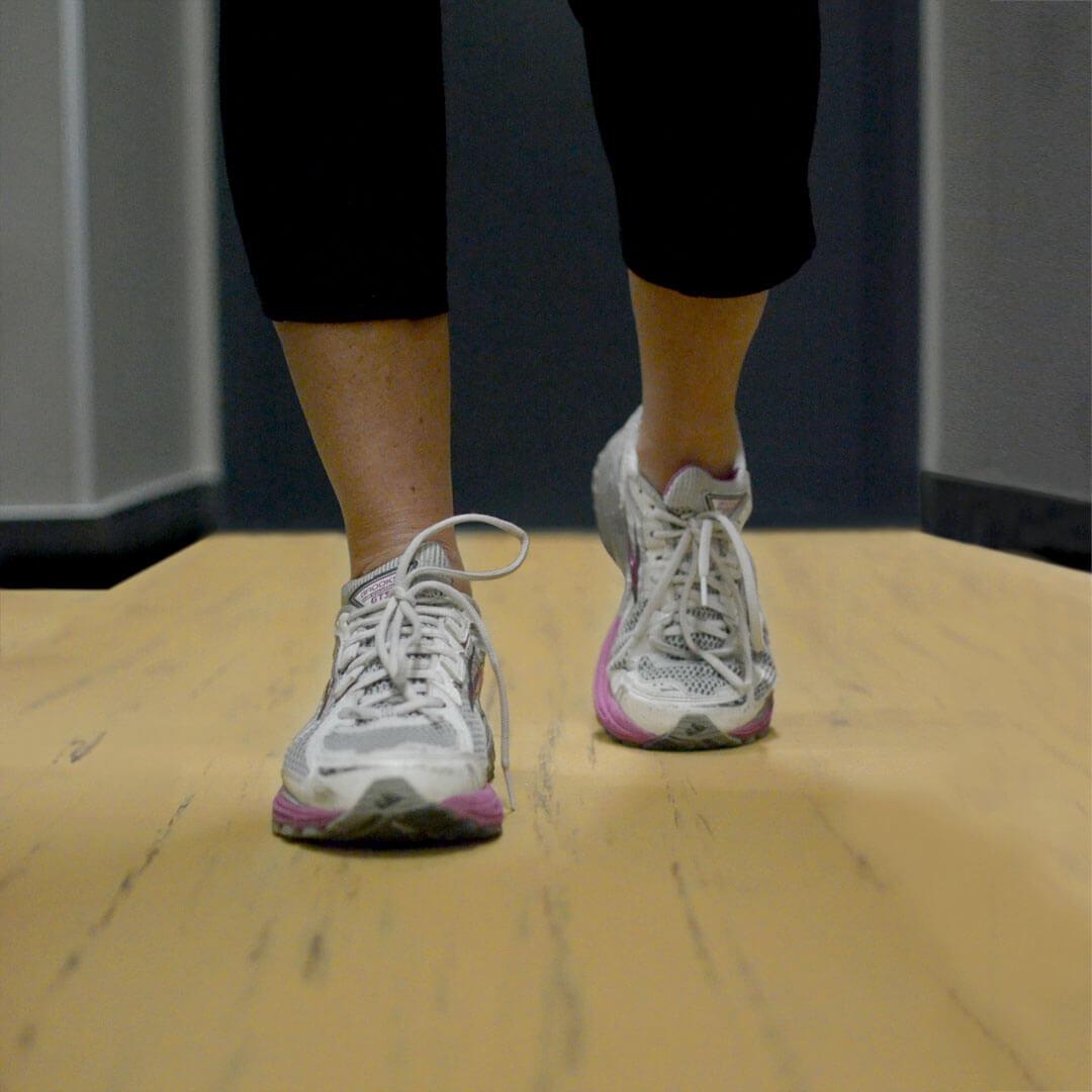 Walking on a rubber sports flooring