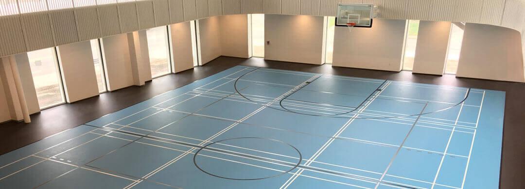 Poured polyurethane gymnasium sports floor in a recreation centre